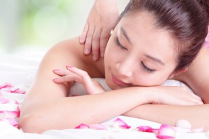 girl with attractive face having a massage for shoulder